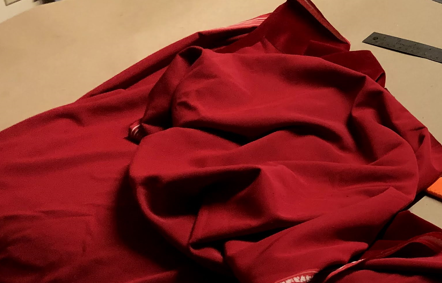 Deep red velvet used to line the bottom of the drawers