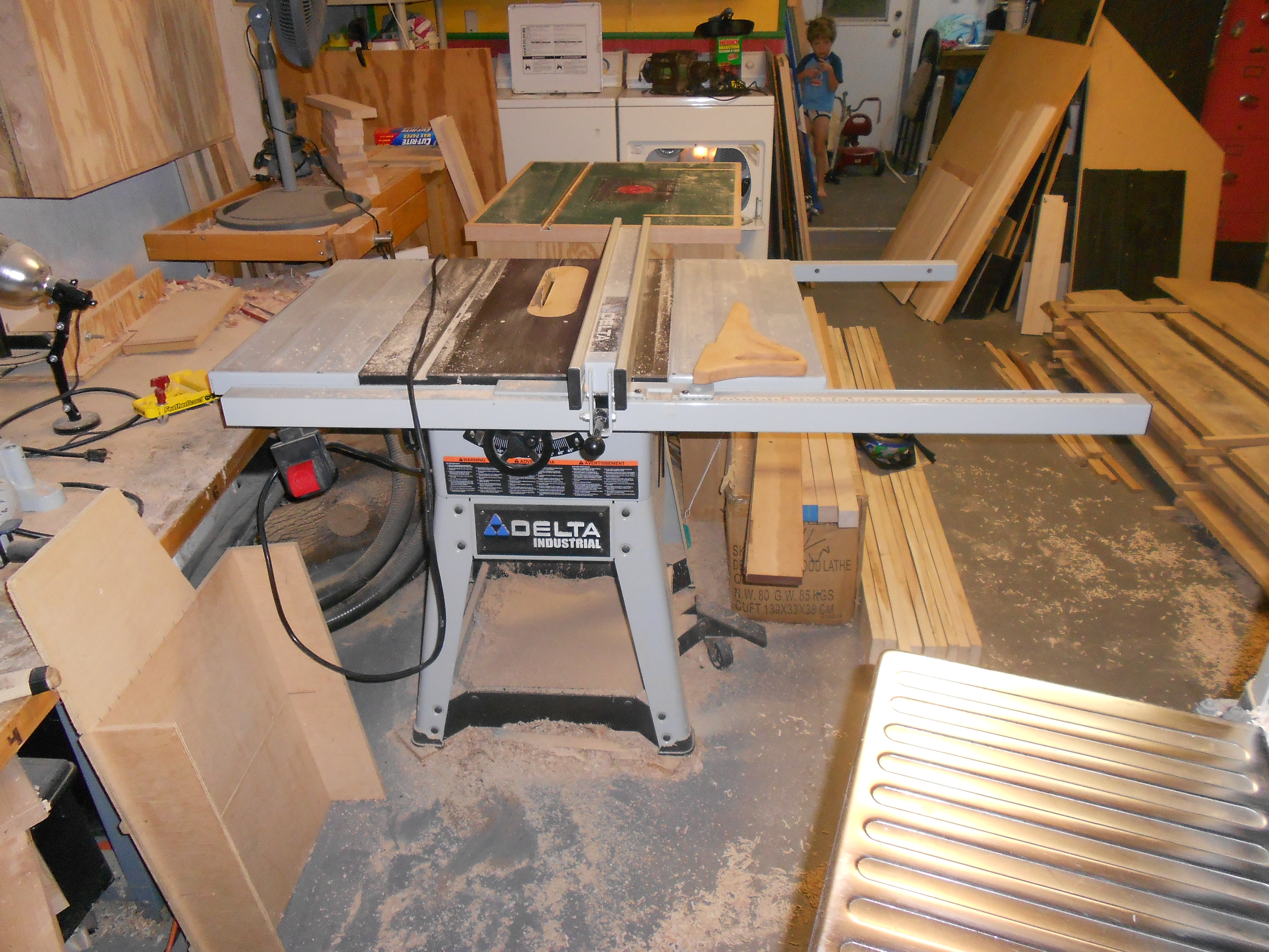 "Table saw set up for ripping lumber to 4 1/2"" laminate strips"