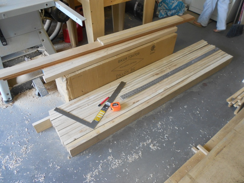 7' long slats to be laminated into the benchtop, 15 down. 10 more to go.