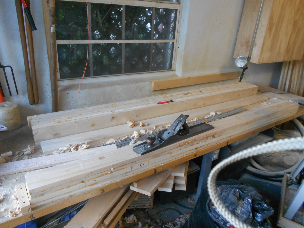 Began by gluing up four slats to make sections of the benchtop, Then planed them flat for further gluing.