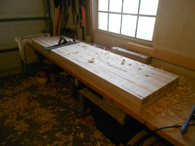 Benchtop glued together, flattening work begins