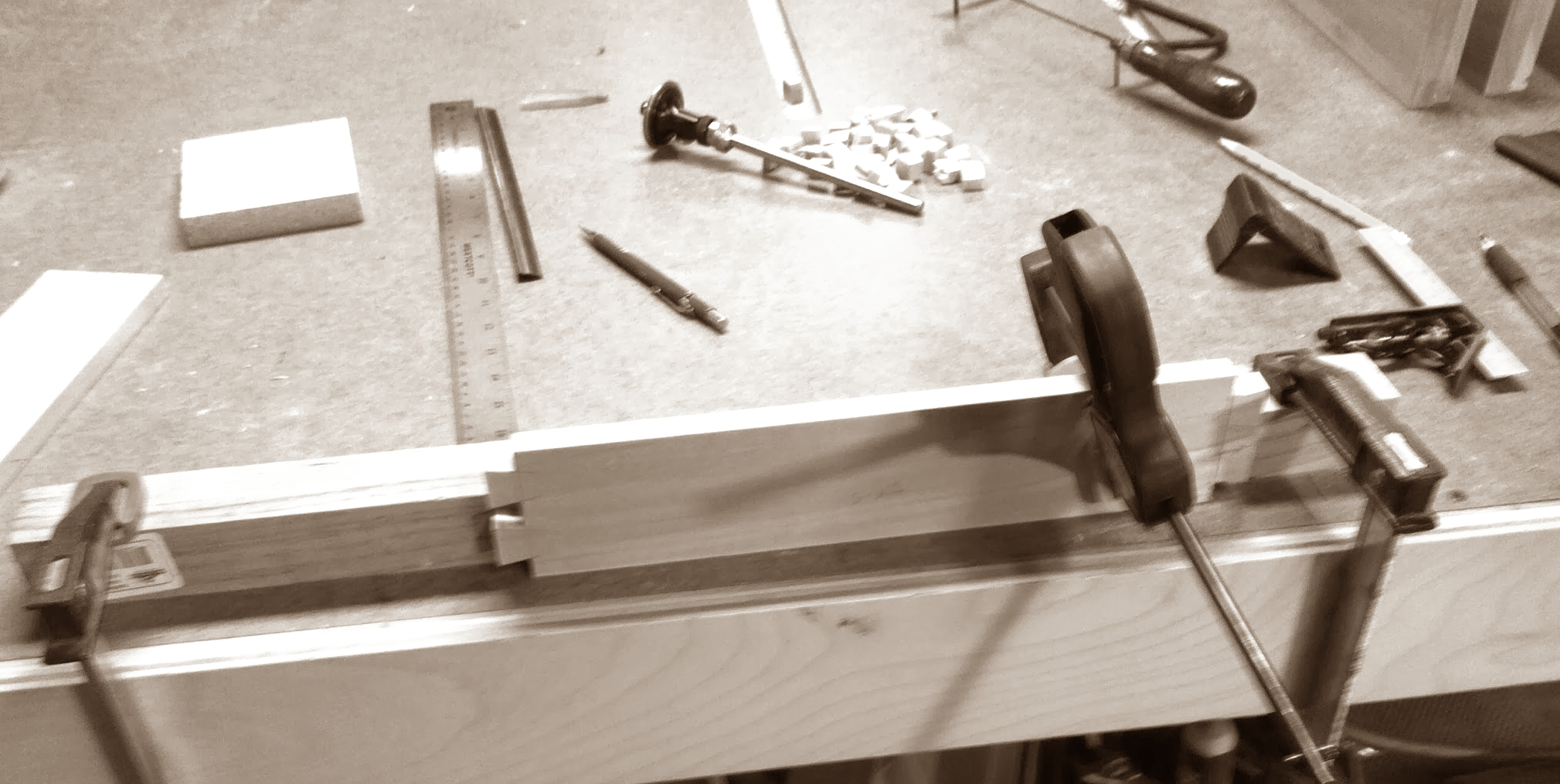 Jury-rigged bracket to hold drawer sides while cutting sides