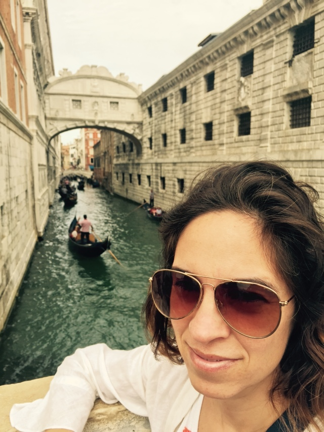 Adriana near a canal in Venice