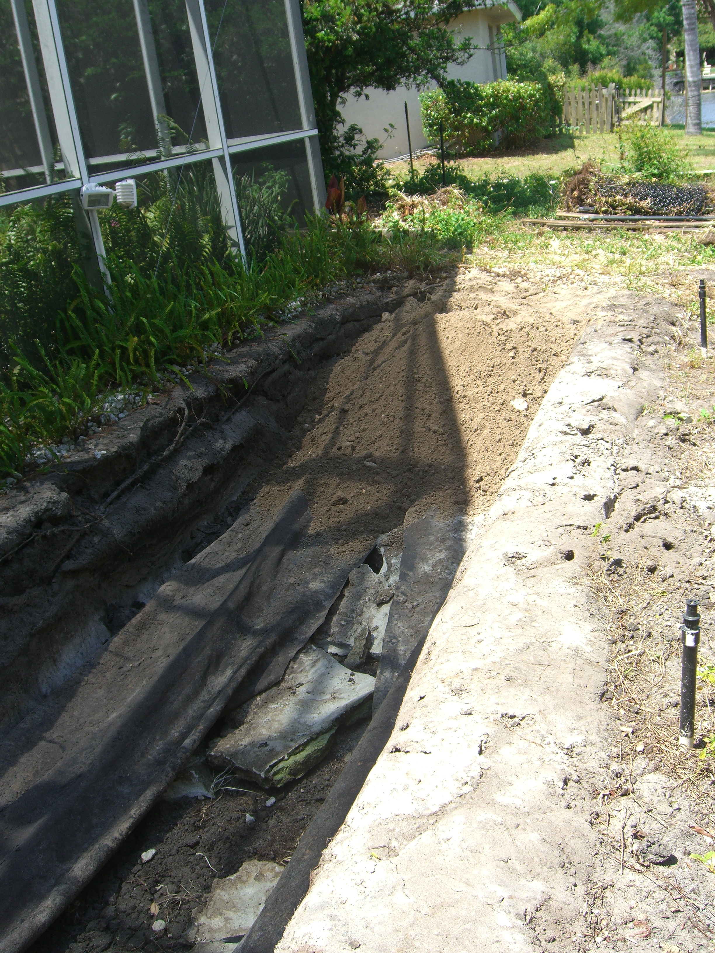 I began filling this 40' long koi pond in March 2009. Knocked in the rock and cement edging and then wheelbarrows of fill