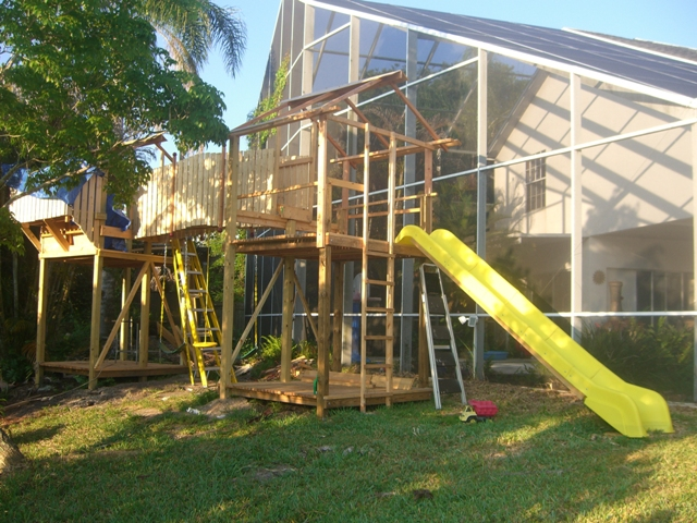 Two and a half months in, fence around balcony. Installing the swings under the bridge