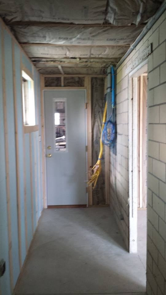 Hall behind the wall where the cabinet will be installed, during remodel