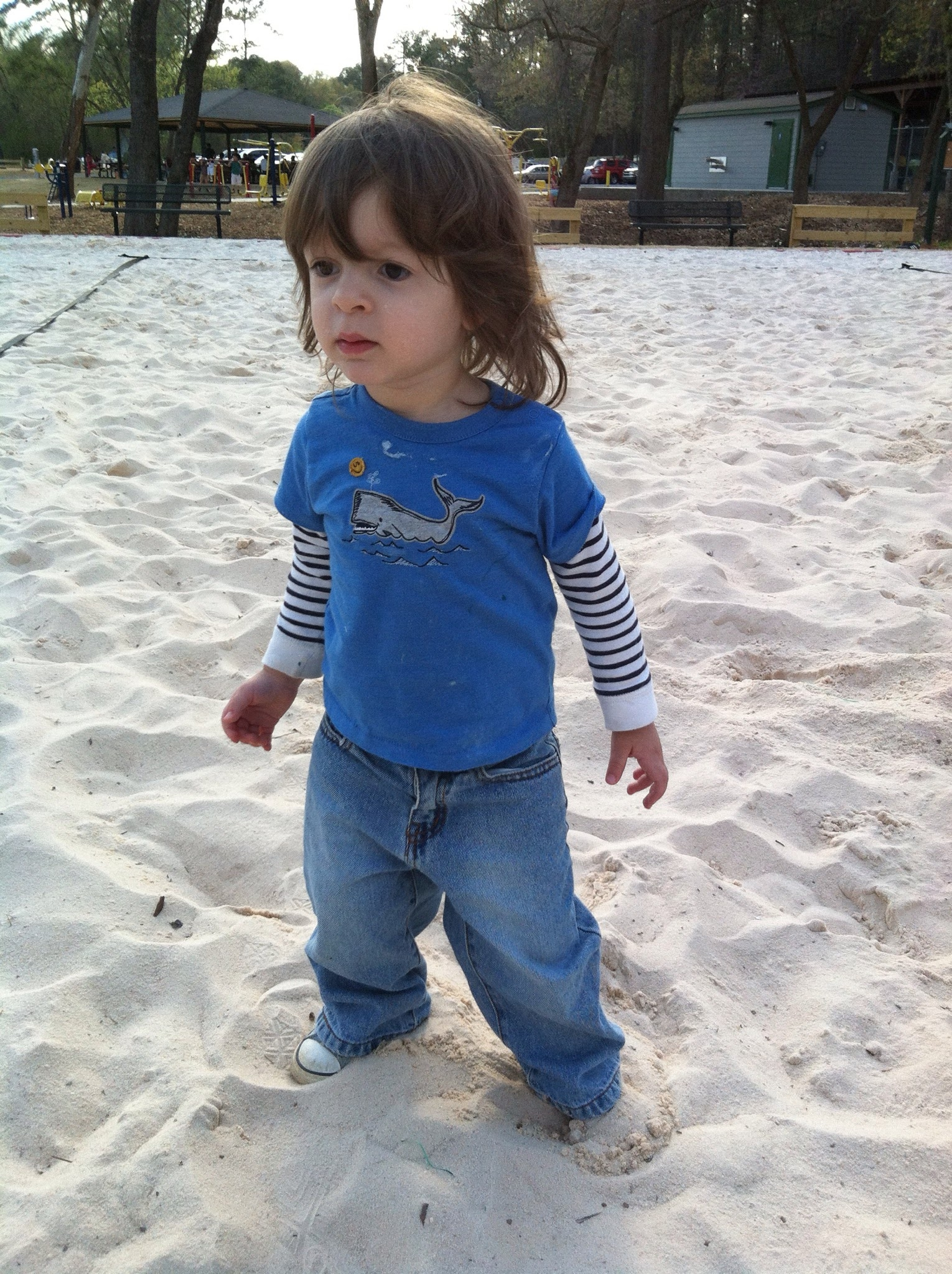 Lucas at 2, playing in the volleyball court sand