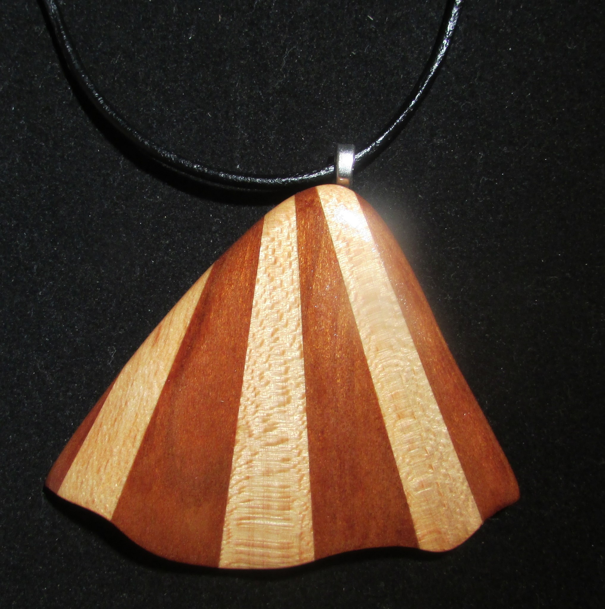"Seafan pendant in cherry and sycamore, 2"" x 3"""
