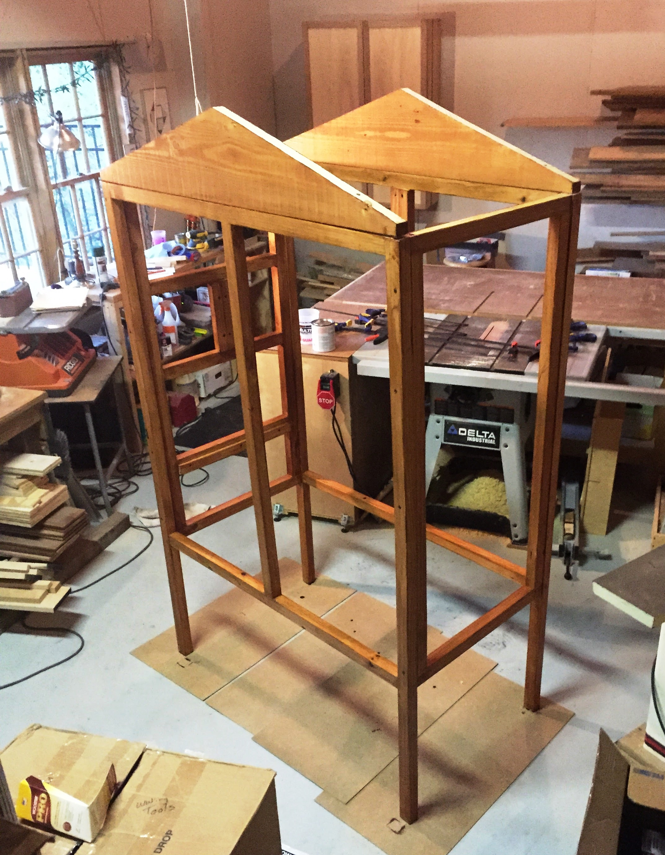 Aviary structure held together with clamps so I can stain it
