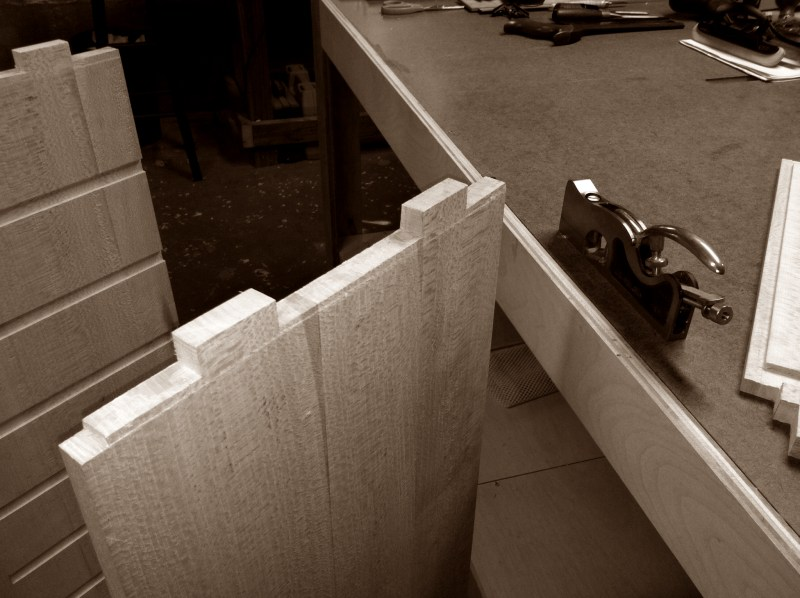 Using shoulder plane to trim case sides around tenons
