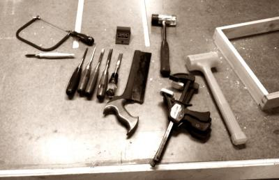 Tools laid out on the outfeed table to work on dovetails