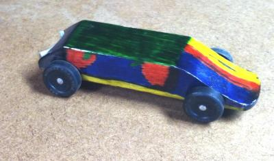 Liam's first attempt at a Pinewood Derby Car. It's supposed to have a Minecraft theme. (He tends to be fairly abstract in his artwork.)