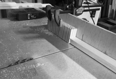Crosscut sled set up to cut half-lap joints on the door frame parts