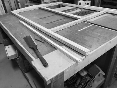 Front wall frame laid out in prepartion to fit a door jamb. I cut the L-shaped jamb pieces on the table saw, then cut them to fit with the ryoba.