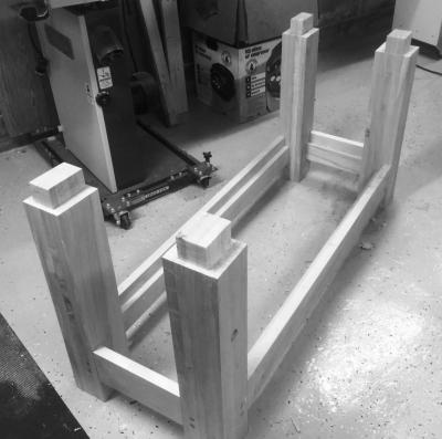 Sizing the tenons to fit the mortises in the benchtop