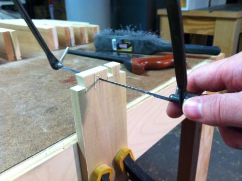 Clearing between dovetails with a coping saw