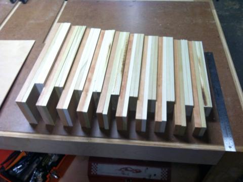 Drawer fronts, backs, and sides cut for the 10 cabinet drawers