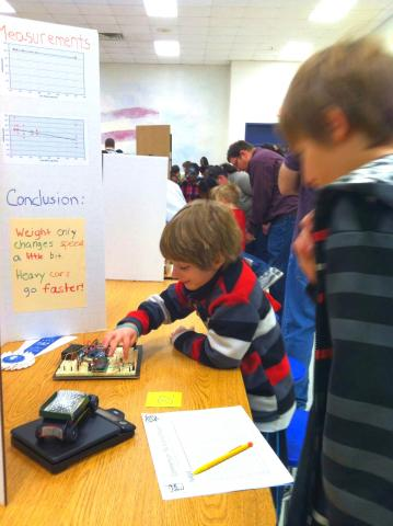 Liam showing off the timer at the science expo