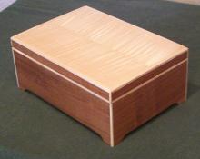 Box out of cherry with maple accents, and flame maple veneer top