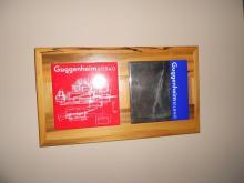 Frame/holder for a pair of Guggenheim trivet tiles in spalted something