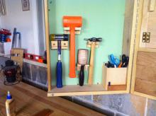 Hammers and mallet mounted in left door of the wall tool cabinet